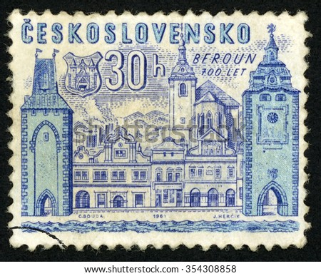 CZECHOSLOVAKIA - CIRCA 1965: post stamp printed in Czech (Ceskoslovensko) shows coat of arms and view of Beroun; 700th anniversary of founding Bohemian towns; Scott 1282 A491 30h blue; circa 1965 - stock photo