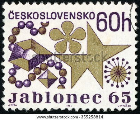 CZECHOSLOVAKIA - CIRCA 1965: post stamp printed in Czech (Ceskoslovensko) shows Jablonec 1965 costume jewelry exhibit; Scott 1330 A506 60h purple gold; circa 1965 - stock photo