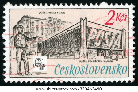 CZECHOSLOVAKIA - CIRCA 1988: post stamp printed in Czech (Ceskoslovensko) shows Prague 1 (1873) and Bratislava 56 (1984) post offices; man with letter; Praga 88 emblem; Scott 2698 A968 2k; circa 1988 - stock photo