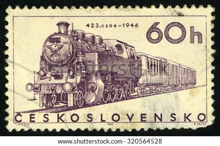 CZECHOSLOVAKIA - CIRCA 1966: post stamp printed in former Czechoslovakia (Ceskoslovensko) shows steam engine 1946; locomotives; Scott 1376 A523 60h purple; circa 1966 - stock photo