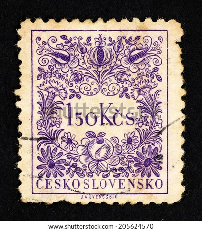 CZECHOSLOVAKIA - CIRCA 1954: Purple color postage stamp printed in Czechoslovakia with image of curly floral pattern. - stock photo