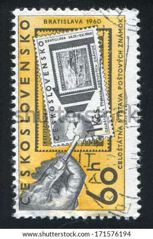 CZECHOSLOVAKIA - CIRCA 1960: stamp printed by Czechoslovakia, shows Hand with tongs and two stamps, circa 1960 - stock photo