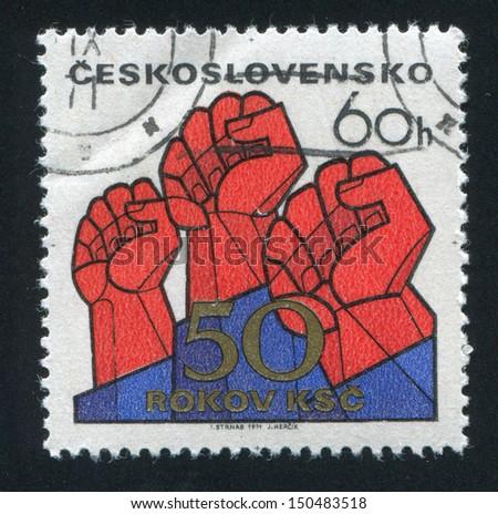 CZECHOSLOVAKIA - CIRCA 1971: stamp printed by Czechoslovakia, shows Raised fists, circa 1971 - stock photo