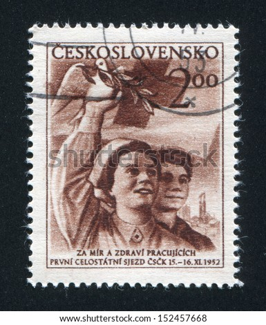 CZECHOSLOVAKIA - CIRCA 1952: stamp printed by Czechoslovakia, shows Worker and Nurse Girl Holding Dove and Branch, circa 1952 - stock photo