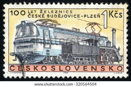 CZECHOSLOVAKIA - CIRCA 1968: stamp printed in former Czechoslovakia (Ceskoslovensko) shows steam & electric locomotives; 100th anniversary of Ceske Budejovice to Plzen (Pilsen) railroad; Scott 1557 1k, circa 1968 - stock photo