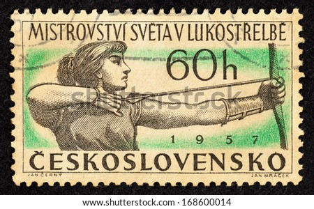 CZECHOSLOVAKIA - CIRCA 1957: Stamps printed in Czechoslovakia with image of a female archer for the World Archery Championships, circa 1957. - stock photo