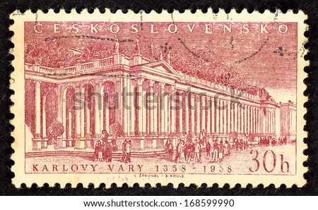 CZECHOSLOVAKIA - CIRCA 1958: Stamps printed in Czechoslovakia with image of the Thermal Spring Colonnade in the spa city of Karlovy Vary in Western Bohemia, circa 1958. - stock photo