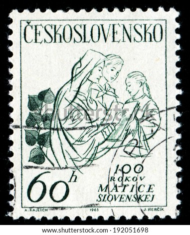 "Czechoslovakia, CIRKA -1965: stamp show three women and the words ""100 years matrix Slovakia"", CIRKA-1965. - stock photo"