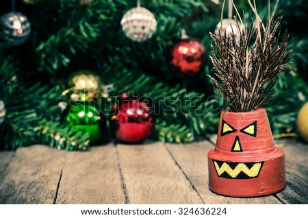 D.I.Y Painted Halloween Pumpkin Plant Man on Wooden Background Texture - stock photo