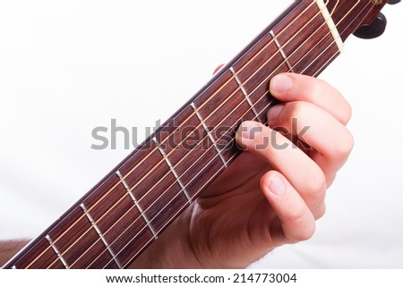 D major chord performed on acoustic guitar - stock photo