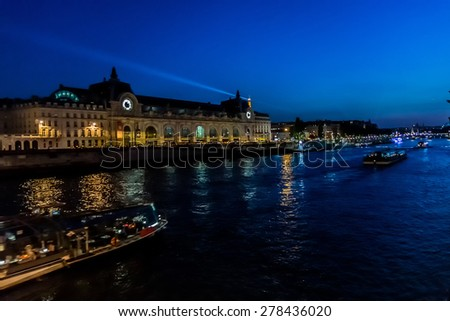 D'Orsay Museum on left bank of Seine at night. Museum is housed in former Gare d'Orsay. Orsay holds mainly French art dating from 1848 to 1915. Paris, France. - stock photo