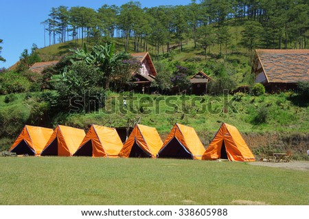 DA LAT, VIET NAM- NOV 9: Cu Lan village at Dalat countryside, hotel and holiday resort among pine jungle, camp on grass field, an eco tourism in nature reserse, Dalat, Vietnam, Nov 9, 2015
