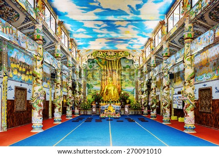 DA LAT, VIETNAM - MARCH 20, 2015: Golden Buddha statue in the main hall of the Linh Phuoc Pagoda in Da Lat city (Dalat), Vietnam. Da Lat is a popular tourist destination of Asia. - stock photo