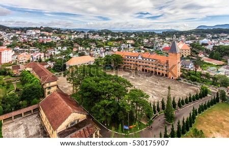 DA LAT, VIETNAM, NOV 20, 2016: University landscape in the city of Da Lat , highland Da Lat city fog in the morning ( view from drone )