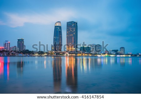 Da Nang panorama view by Han river by twilight period. Da Nang is one of the major port city in Vietnam and the biggest city in Central Vietnam - stock photo
