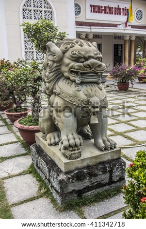 DA NANG, VIETNAM - FEBRUARY 23, 2016: A lion at the Cao Dai temple of Da Nang, Vietnam. The Cao Dai religion is the third largest religion in Vietnam.
