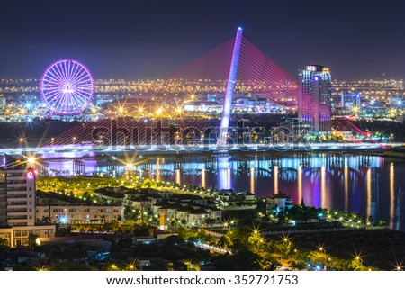 Da Nang, Vietnam, 25th June, 2015: Architecture sail bridge night with the lights of the bridge shaped sails shimmering beneath the city lit up at night makes the city more lively in Danang , Vietnam