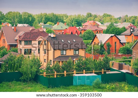 dacha, country cottages. modern country houses - stock photo
