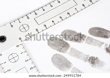 Dactyloscopy and fingerprint on the sheet of papper - stock photo