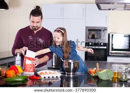 Dad and daughter preparing - stock photo