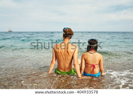 Dad and daughter swimming in the sea. family on beach on vacation