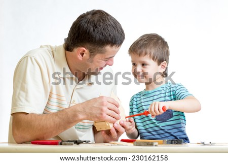 Dad and kid boy working isolated on white background