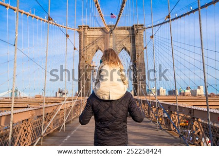 Dad and little girl on Brooklyn bridge, New York City, USA - stock photo