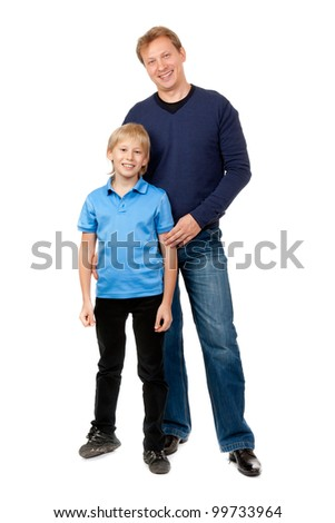 Dad and son are in the studio on a white background - stock photo