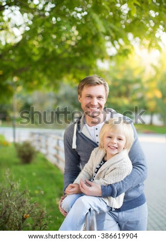 Dad and son in park