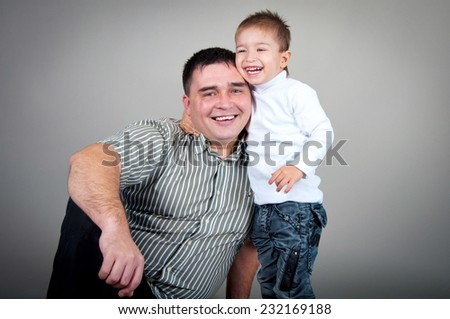 Dad and son in the studio, dad and son hugging - stock photo
