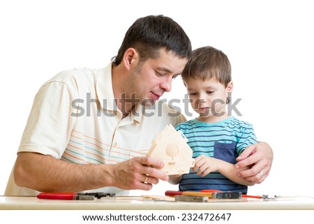 Dad and son kid teach building nesting box isolated