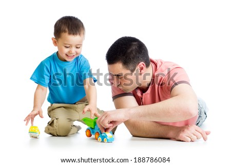 Dad and son playing together - stock photo