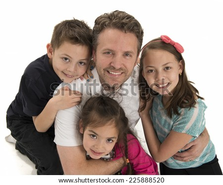 dad and three children / express positivity / and hug each other - stock photo