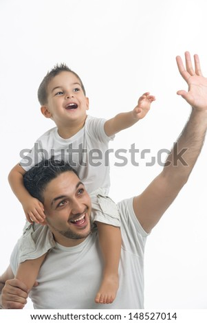 Dad carrying his son on shoulder