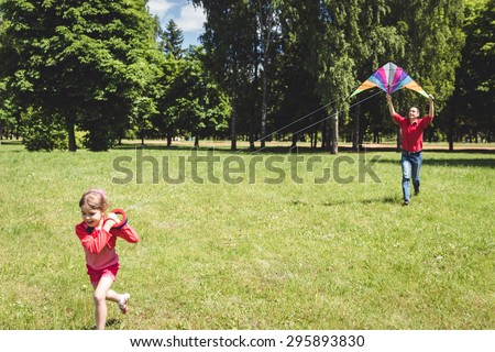 Dad devotes time to the child. Father playing with his daughter. Sky kite. - stock photo