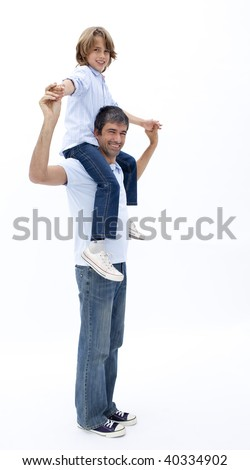 Dad giving little boy piggy back ride against white background - stock photo