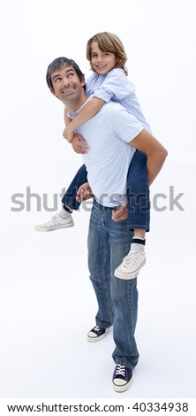 Dad giving son piggy back ride against white background
