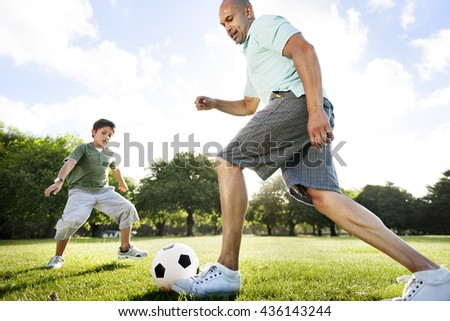 Dad Son Playing Football Together Concept - stock photo