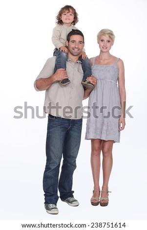 Dad standing next Mum - stock photo