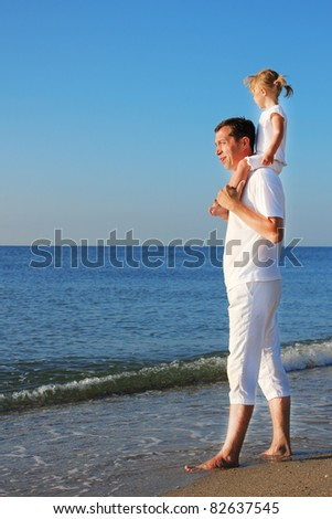dad with baby on the shore of the sea