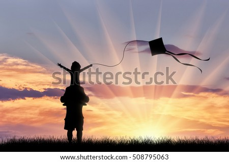 Dad with child playing with kite sunset nature. Concept family