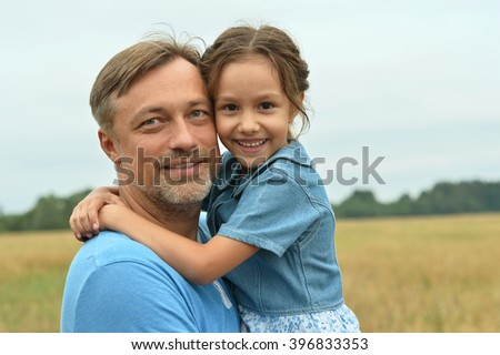 Dad with daughter in field