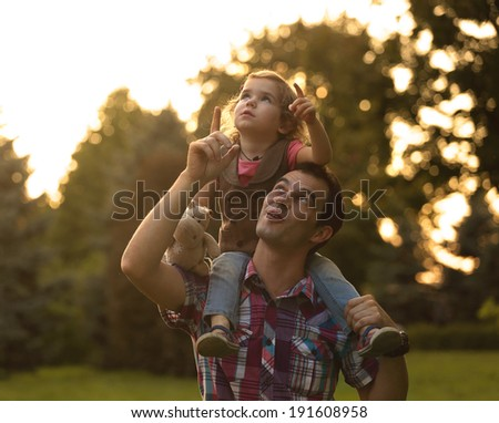 dad with daughter outdoors   - stock photo