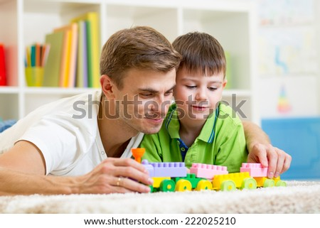 dad with his kid son play together - stock photo