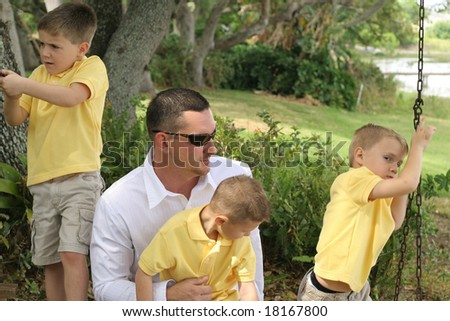 Dad with 3 sons - stock photo