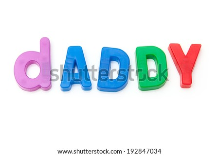 Dad written in magnetic letters isolated on a white studio background.