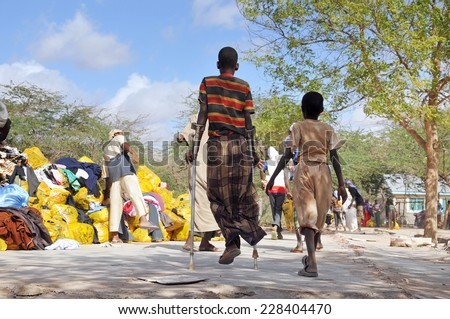 DADAAB, SOMALIA-AUGUST 07: Dadaab refugee camp to get help from crutches young Dadaab, Somalia on August 7, 2011. Thousands of Somali immigrant camp's people. - stock photo