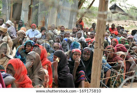 DADAAB, SOMALIA - AUGUST 7: Unidentified women and men live in the Dadaab refugee camp hundreds of thousands of Somalis wait for help because of hunger on August 7, 2011 in Dadaab, Somalia. - stock photo