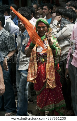 DADAR, MAHARASHTRA / INDIA - AUGUST 14, 2009 : A WOMAN PLAYING A MUSICAL INSTRUMENT, CYMBALS DURING THE HINDU GOD KRISHNA FESTIVAL IN INDIA. - stock photo