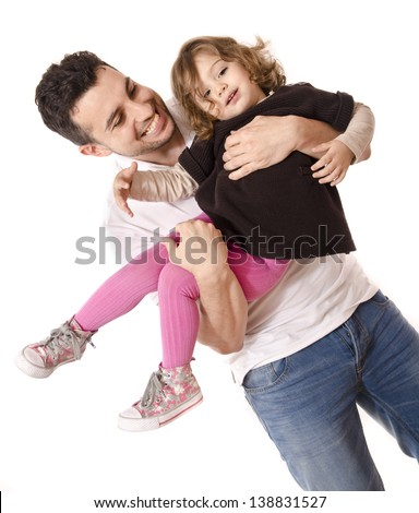 Daddy and daughter playing. Adult and little girl isolated over white.